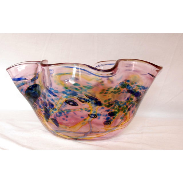 Beautiful free-form hand blown art glass bowl. Multicolored design with blue greens and yellows. An original piece of art.