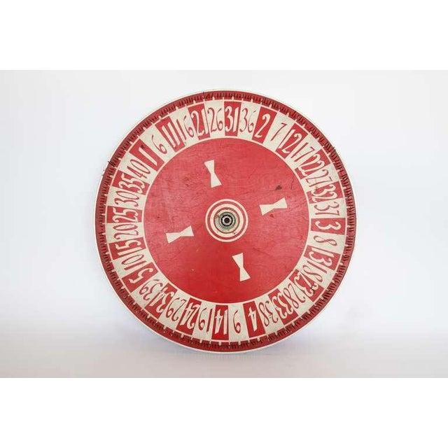 Vintage hand painted game wheel.
