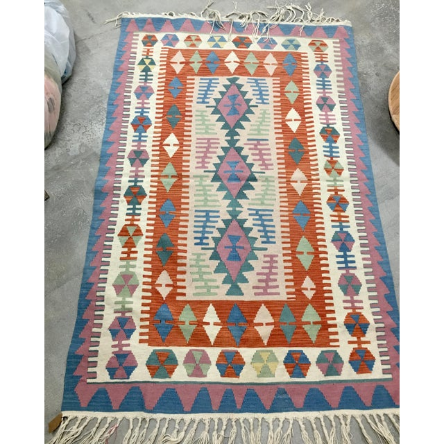 Turkish Kilim Rug in pastels and burnt orange, great combination! Wool handwoven rug. Not sure what period it was made....