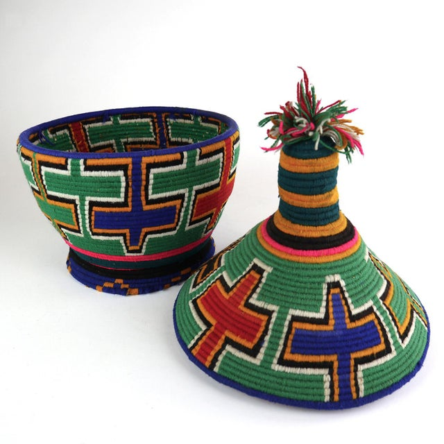 Moroccan Berber wool and straw basket traditionally used to hold and transport bread (khobz), these graphic vessels can be...