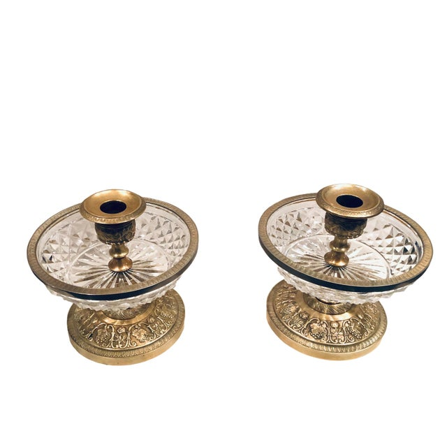 These neo-classical style Baccarat doré bronze candle holders that can also hold flowers will add a sparkle to any table...