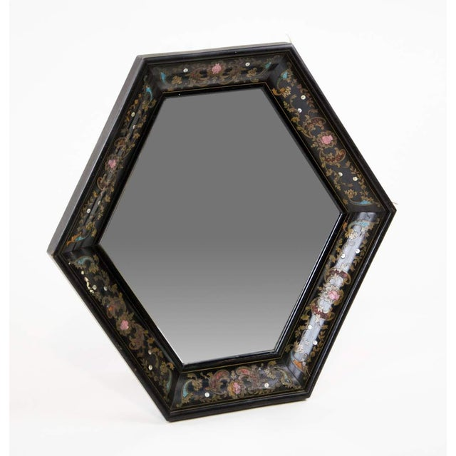 This absolutely stunning Italian style painted and brass inlaid hexagonal wall mirror will take your breath away. The...
