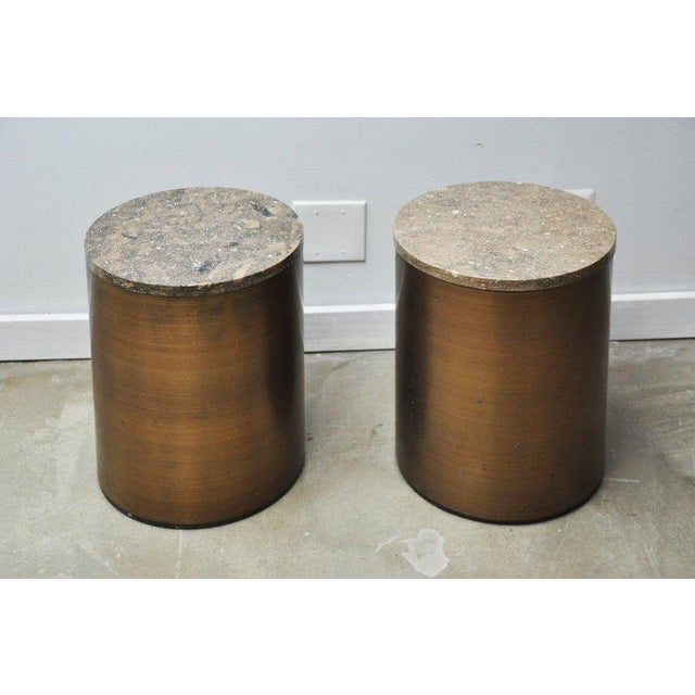 Bronze tone side tables by Paul Mayan. Each piece has a travertine top.