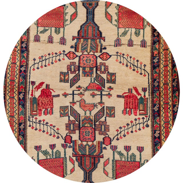 A beautiful Vintage hand-knotted Persian rug with an ivory field, and multicolor accents in an all-over geometric design....