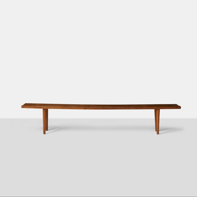 A unique oak bench made in 1955 with a carved texture typical of Jean Touret's work. The seat is made of one solid oak...