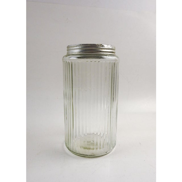 Ribbed glass canister with zinc lid. Made for Hoosier kitchen cabinets, this one has COFFEE embossed on the side. There...