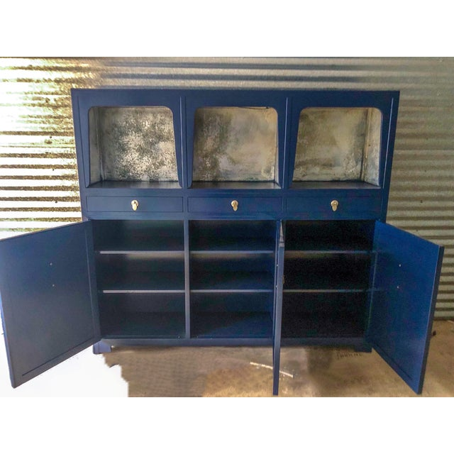 1970s credenza or tall cabinet designed by Michael Taylor for Baker Furniture as part of the Far East Collection. The top...