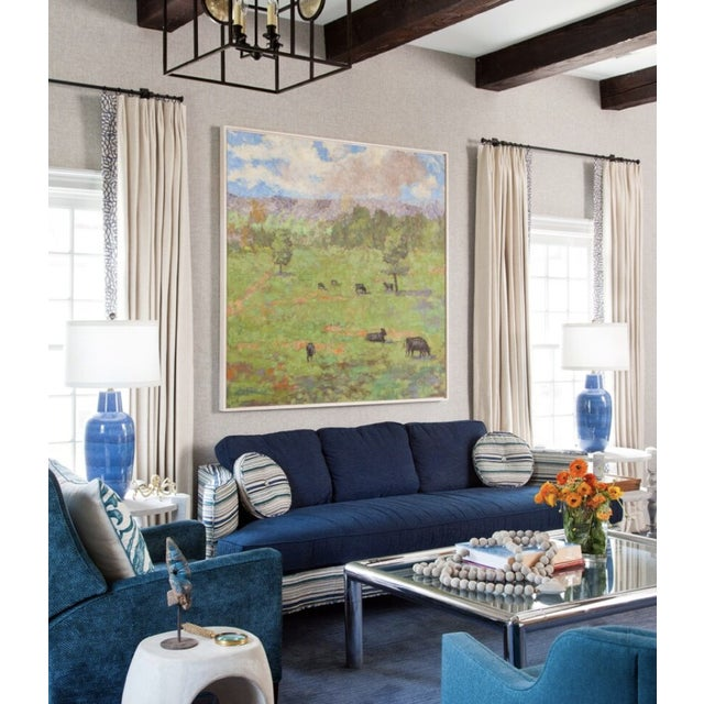 A beautifully tailored custom sofa , with curved arms. Seat and back cushions are upholstered in a navy blue chenille,...