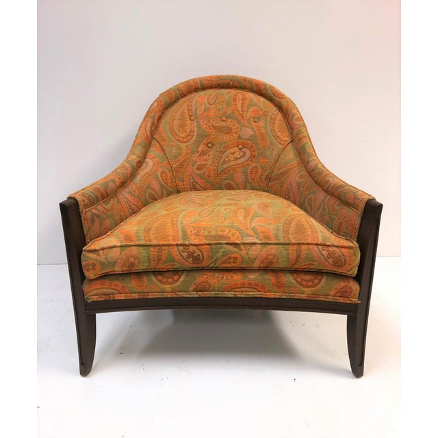 Pair of lounge chairs. Has the original paisley print fabric with a walnut frame.
