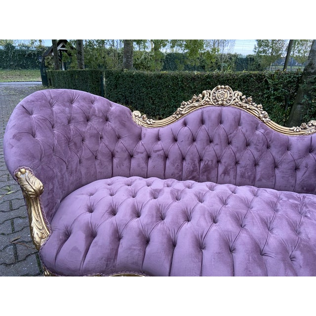 A wonderful French Louis XV sofa. The sofa was recently upholstered with tufted velvet and the massive handmade beech...
