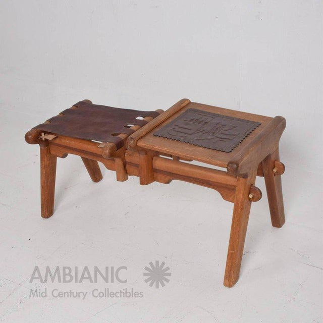 """For your consideration a vintage stool with table by Angel Pazmino. Saddle leather with solid wood. 19"""" tall x 19"""" W x 40""""..."""