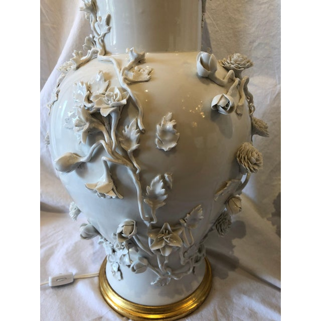 Pair of gorgeous Chinese white blanc d'chine porcelain vase lamps. Encrusted with flowers. Republic Period. Measures:...