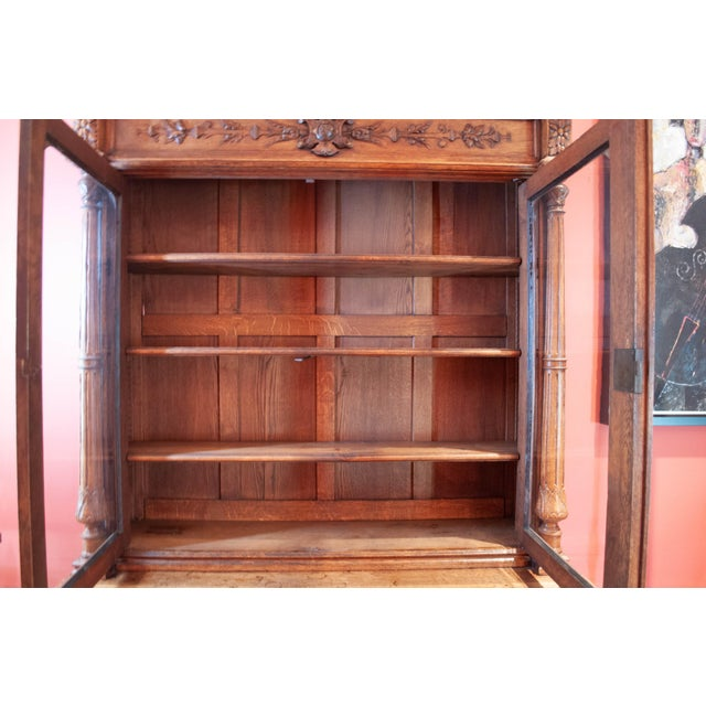 Highly carved French antique display cabinet/bookcase. From the Brittany region of France and made from solid French Oak....