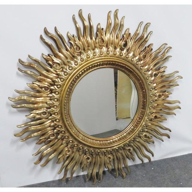 Large Syroco Mid Century sunburst mirror. Gold gilt finish.