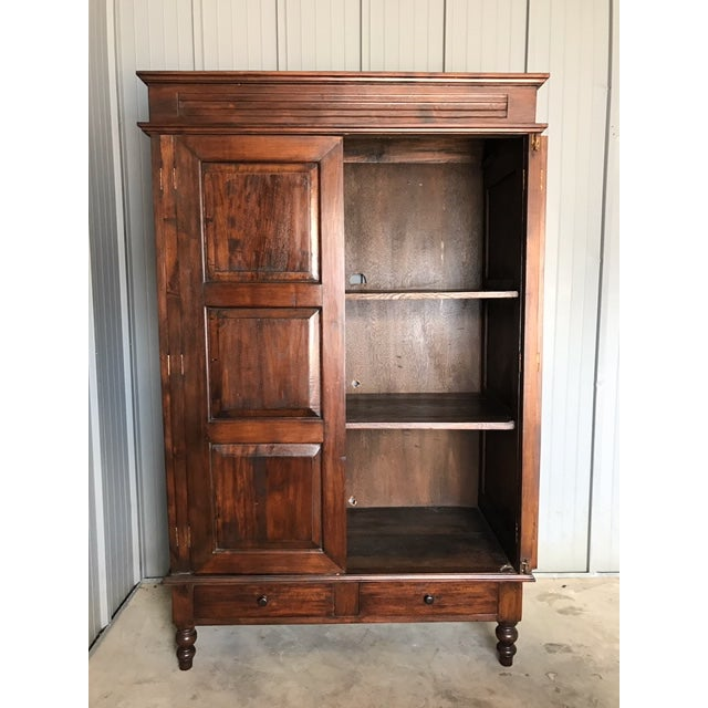 Large Teak Armoire Made from reclaimed teak wood. I believe this was custom made for someone. Measures 4ft by 6ft 6 in by...
