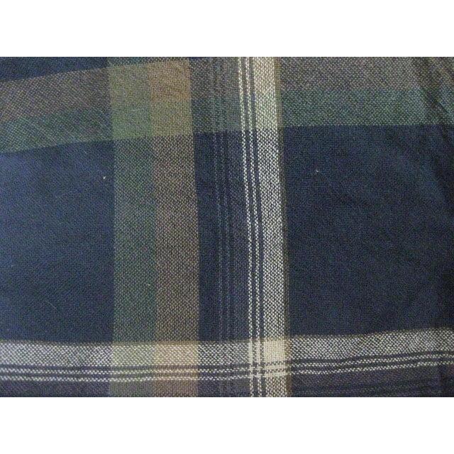 Classic light weight cotton throw with fringed edge. The colors in the plaid fabric are navy blue, dark green, cream, and...