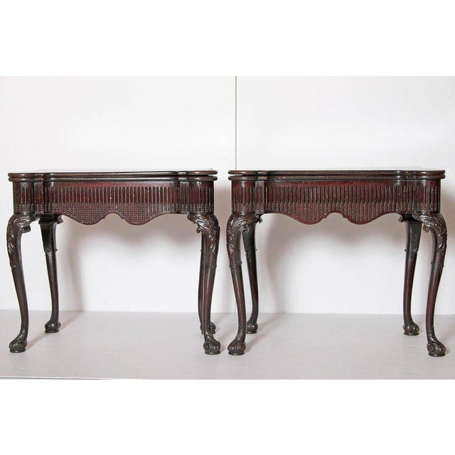 A desirable pair of Irish Chippendale mahogany card tables. The turret fold over top reveals a polished wooden playing...