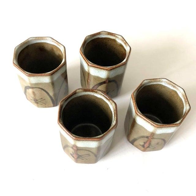 "Mid-Century vintage stoneware sake cups; set of 4. Each cup: 2.25"" diameter x 3"" height"