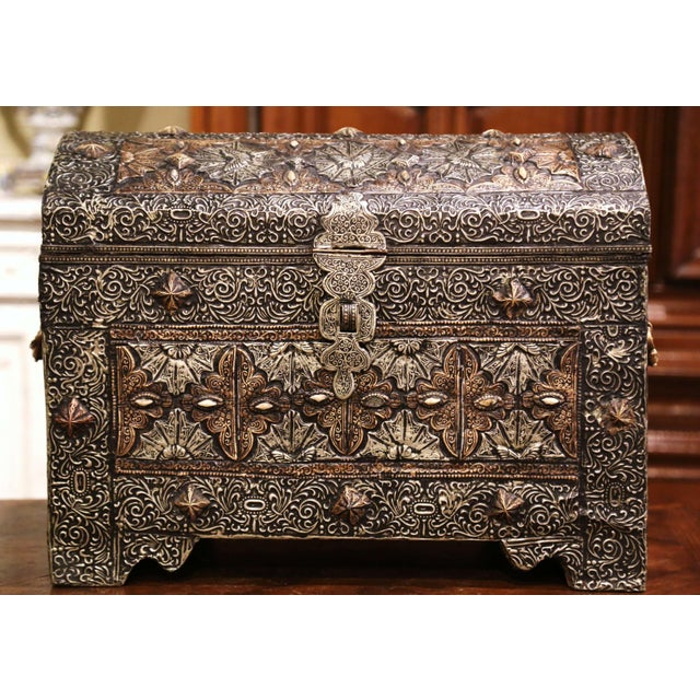 This elegant antique chest was crafted in Spain circa 1780. Bombe in shape and built of wood with copper, the trunk with...