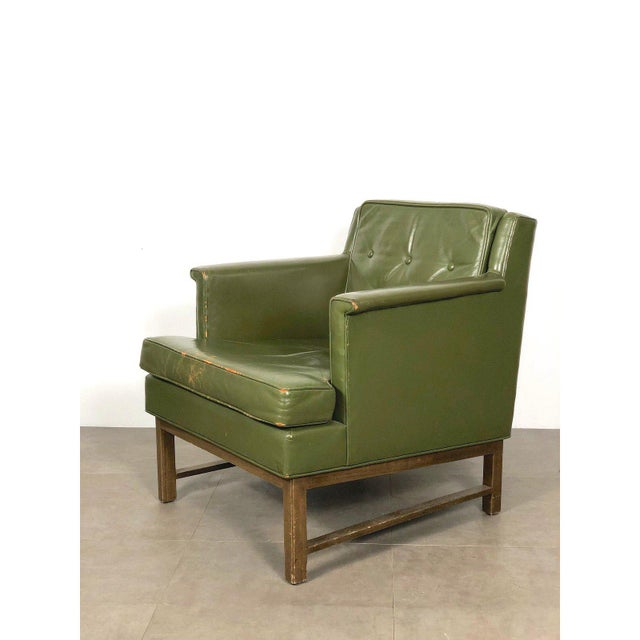 Classic vintage petite lounge chair designed by Edward Wormley for Dunbar. Circa 1950's. Original olive green leather,...