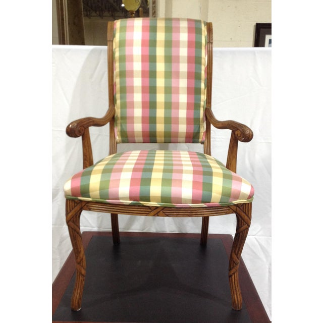 Pretty French style arm chairs in a lovely multi plaid blend of complimentary colors. Lots of detailing on a fruitwood...