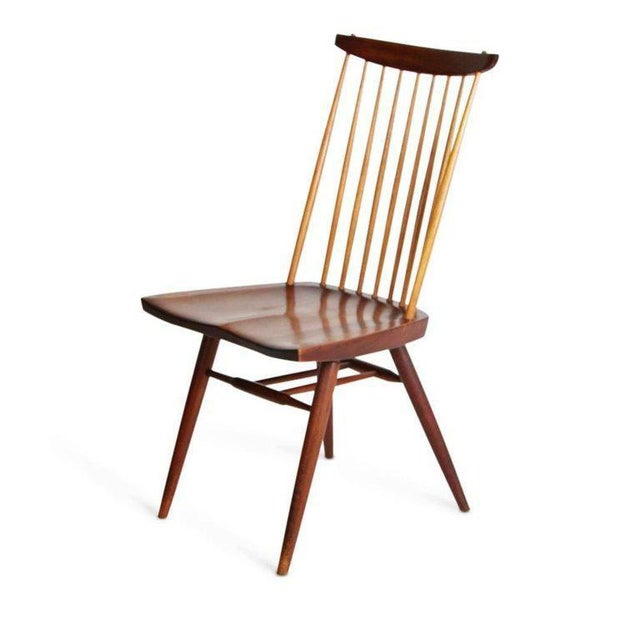 "This is a remarkable set of eight (8) walnut and hickory ""New"" chairs by George Nakashima and authenticated by his..."
