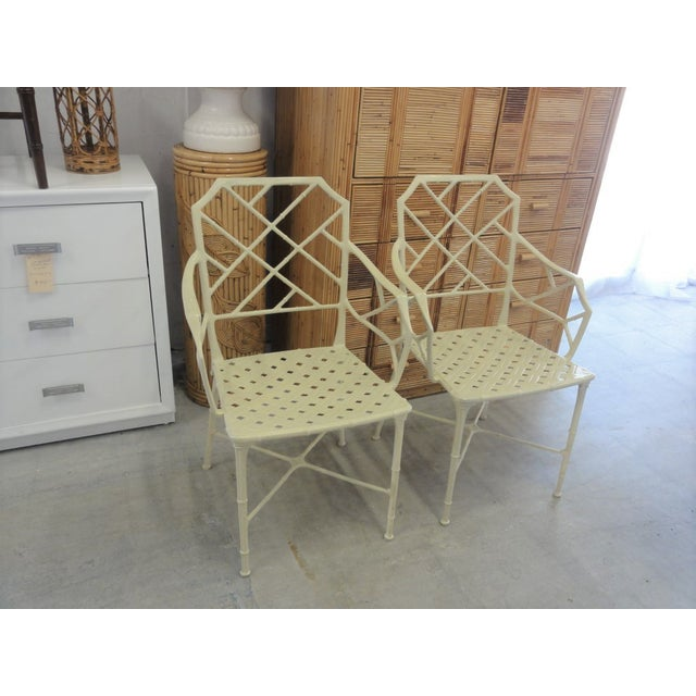 Pair of Brown Jordan Chippendale Faux Arm Bamboo Chairs. They are in nice as found VINTAGE condition with some chips to...