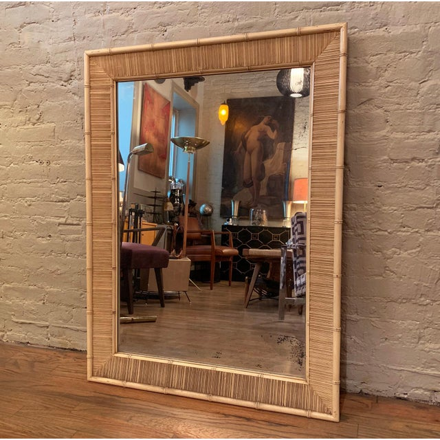 Mid century, wall mirror attributed to Paul Frankl for Johnson Furniture features a bamboo motif, mahogany frame. Can be...