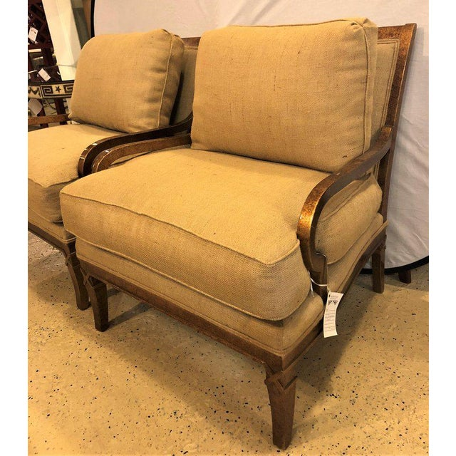 Pair of Burlap faux marbleized bergère or armchairs in the Hollywood Regency style. These very stylish and sleek lounge...