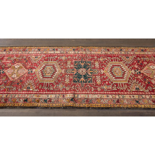Vintage hand-knotted Persian Heriz rug with a geometric multi-medallion design. This piece has magnificent detailing and...
