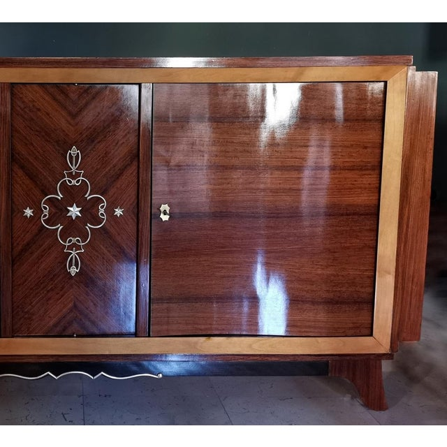 Cupboard with hidden cocktail cabinet, produced in France circa 1940 with fine exotic woods, carefully restored.