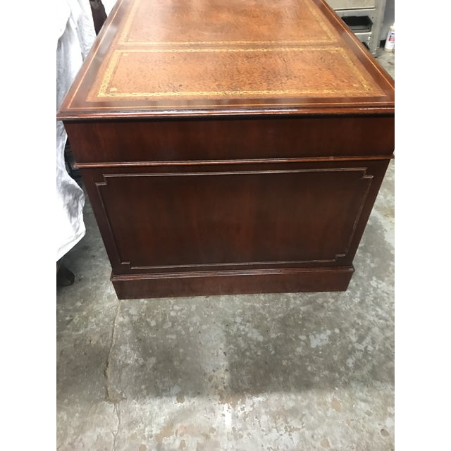 English custom made mahogany executive desk with tan leather tooled top and satinwood banding trim. Computer drop-down...