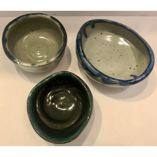 Set of 3 artistic potteries signed Cata on bottom. Beautiful colors and shapes. Dimension below are for the larger one....