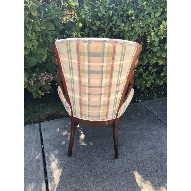 Pretty little side chair with beautiful wood carving detail. Has been recovered in a lovely plaid fabric.