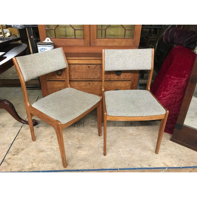 Mid-Century Modern Danish oak chairs with gray speckled cushions. Maker unknown.