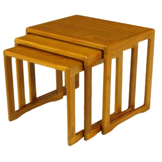 Three Teak Wood Sled-Base Nesting Tables For Sale
