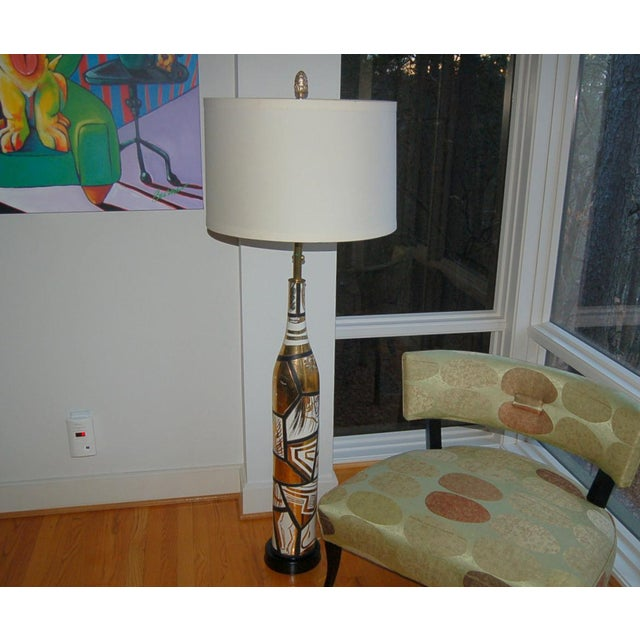 Very rare Italian floor lamp by Marbro with a design reminiscent of Picasso. Stylized faces hand-painted in GOLD framed in...