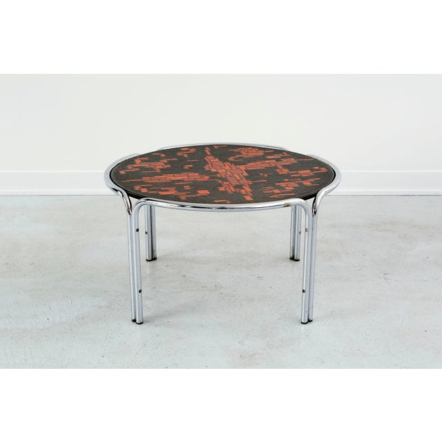 """cocktail table designed by Roger Capron England, c 1960 pressed metal + painted mosaic top over chrome legs 17"""" h x 30 ¾""""..."""