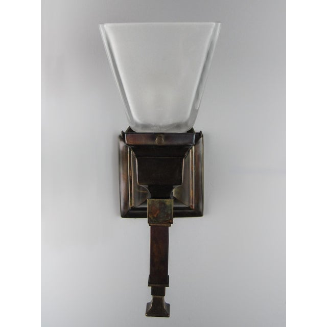New Arts & Crafts Mission sconce with long tail decorative finial. Available in a variety of finishes, white or amber...