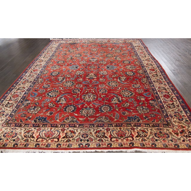 Vintage, hand-knotted Persian rug with an allover design on a red field. This rug has a fabulous color scheme and is ready...