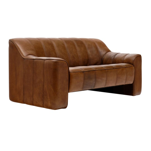 Leather sofa (DS44) by iconic Swiss brand de Sede. This piece has thick patinated Buffalo leather with a bottom that pulls...
