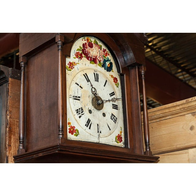American, antique long case clock in running order. Missing glass in bonnet. Cherry wood