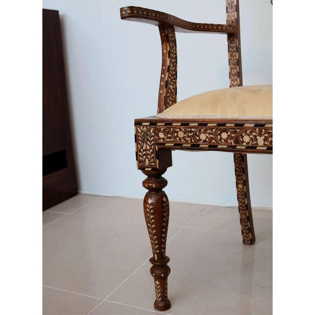 The pierced scrolling back inlaid with bone, the legs stop fluted and tapering, the whole back and front finely inlaid.