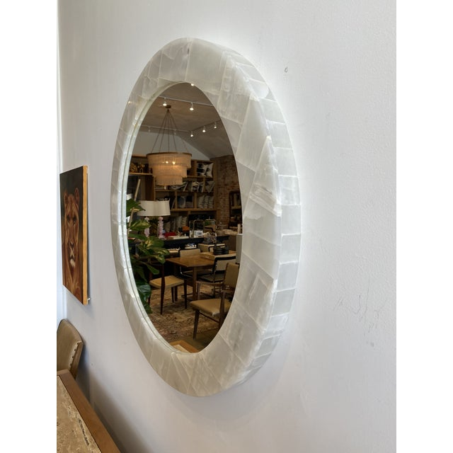 """Round Natural Onyx Mirror. Mirror has a 2-3/8"""" depth. The overall diameter is 36"""". The diameter of the mirror surface is 28""""."""