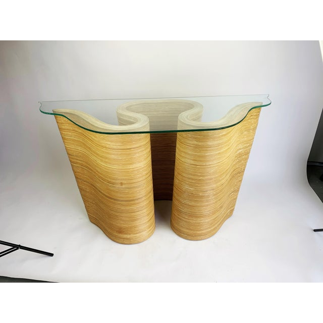 A rare and gorgeous gem! This sultry, flowing pencil reed bamboo console table brings a sense of flowing movement and...