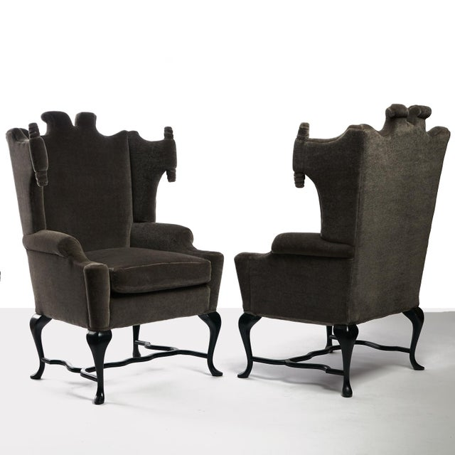 """A rare pair of wingback chairs by Mexican Designer/decorator Arturo Pani. Interesting """"scroll"""" detail on wings, """"Cabriole..."""