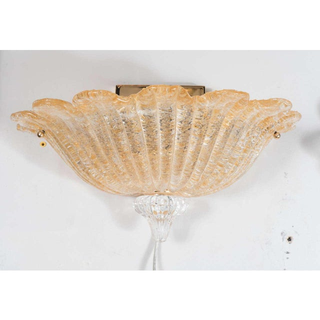 Mid-Century hand-blown Murano glass wall sconce by Barovier e Toso. This elegant sconce by Barovier e Toso is comprised of...