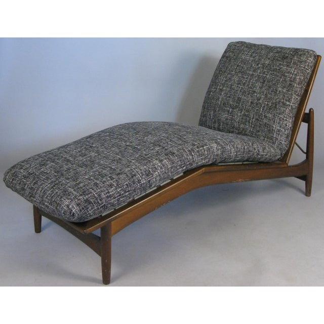 A very handsome Danish modern chaise lounge designed by Ib Kofod-Larsen and imported by Selig. Great design with an...