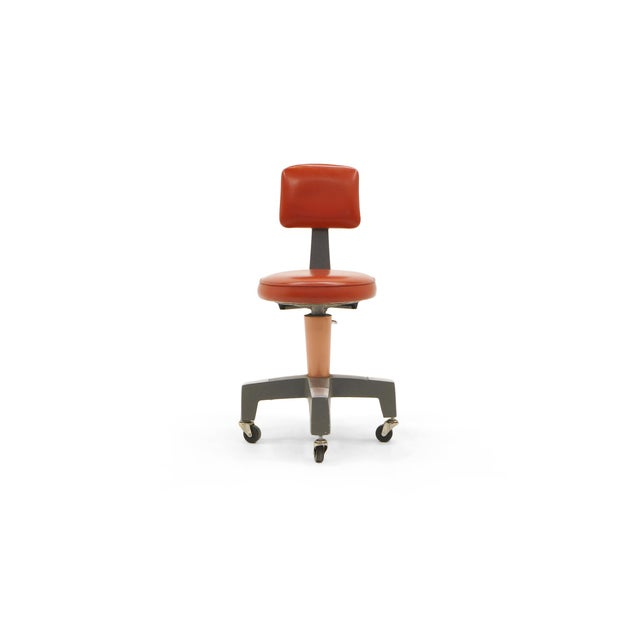 1950s Industrial Design work chair on casters, also swivels. One of the coolest designs we have seen. Would make a great...