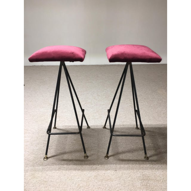 A pair of early iron #11 bar stools by Adrian Pearsall having hand-forged iron and aluminum feet with plastic glides....